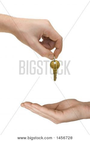 Hands And Golden Key