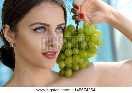 Girl Put A Bunch Of Green Grapes On Her Left Shoulder