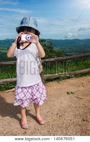 Happy Asian Girl Enjoying And Relaxing Outdoors In The Daytime, Travel On Vacation.