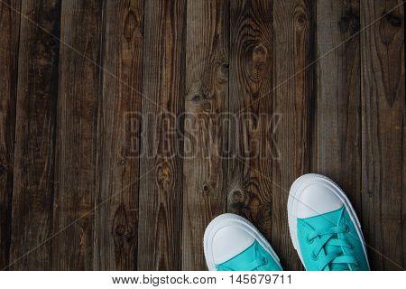 socks of sneakers on wooden floor