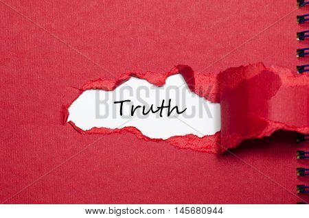 The word truth appearing behind torn paper