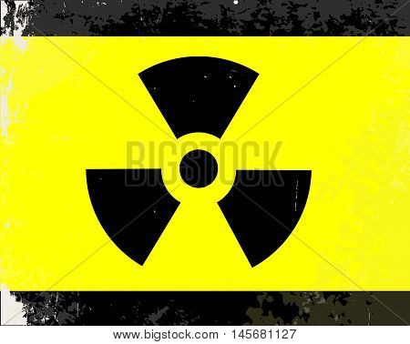 A worn Caution Radiation symbol in yellow and black