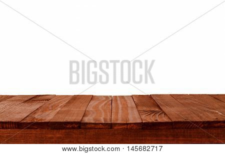 Empty wooden table in a sun drenched summer garden for product placement or montage with focus to the table top in the foreground with white background.