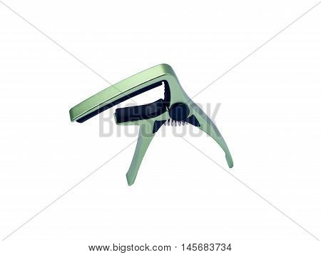 Guitar green capo on white background close up