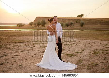 Wedding couple in the sunset light outdoor shot