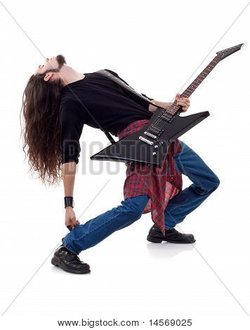 Long Haired Guitarist Is Playing A Guitar