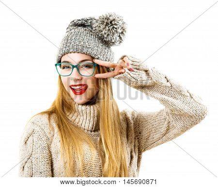 Funny Hipster Girl in Knitted Sweater and Beanie Hat Going Crazy. Isolated on White. Trendy Casual Fashion Outfit in Winter.