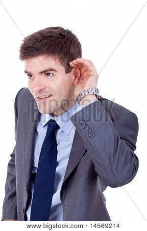 Business Man Cupping Hand Behind Ear