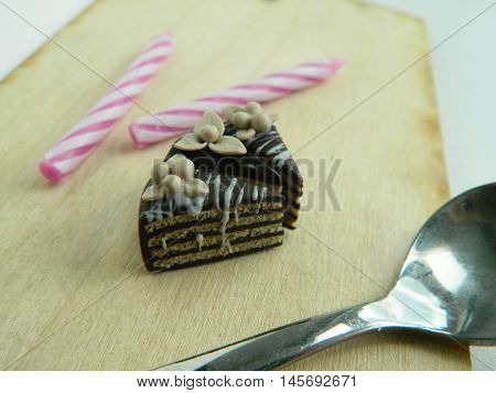 Miniature Polymer Clay Chocolate Cake On The Table