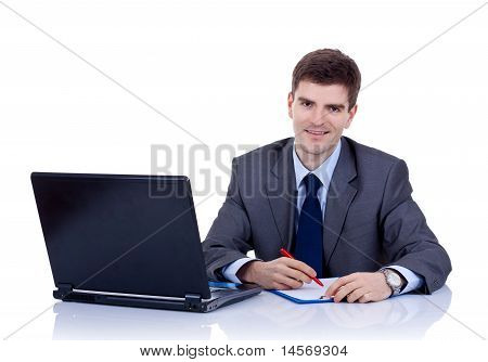 Business Man Writting At Desk