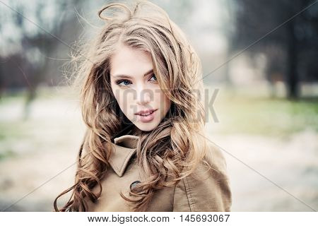 Magnificent Woman Outdoors. Portrait of Beautiful Young Woman