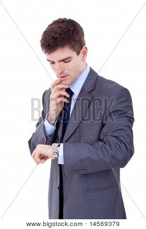 Business Man Looking At The Time