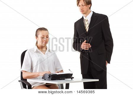 Two businesspeople working with typewriter