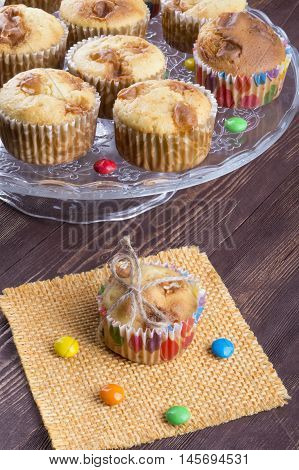 muffin gift. muffins lie on a glass dish. colored candy crumble. holiday fun and tasty.
