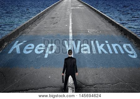 Keep walking message on road and business man