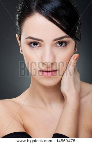 Young Girl Touching Her Face With Hand