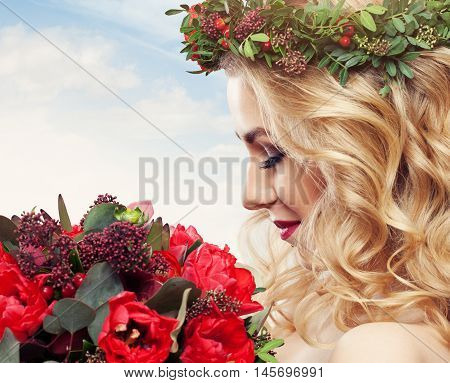 Beautiful Woman with Flowers on sky background