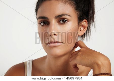 beauty spanish woman's closeup portrait with strobing skin
