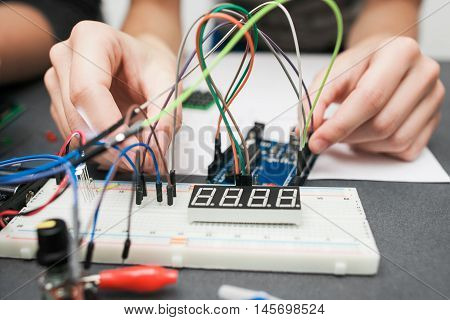 Breadboard with cables close-up. Electronic construction development. Modern technologies, electronics, diy product engineering