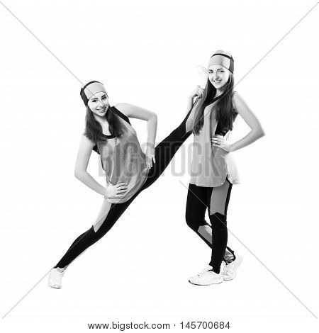 Two Young Professional Cheerleader Are Stretched Before Performance. Isolated Over White.