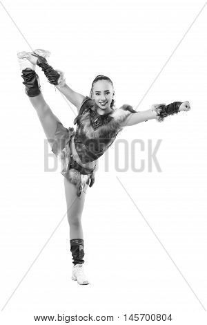 Young Professional Cheerleader Dressed In A Warrior Costume  Standing On One Leg . Vertical Splits