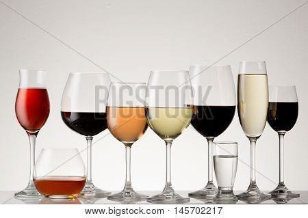 Collection of stemware with drinks with various forms of alcohol.