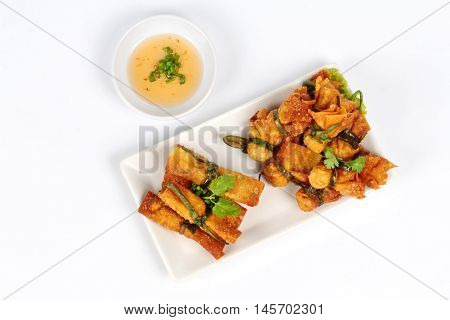 Gold bar and gold bag ,Deep fried Chinese sheet wrap minced pork by shallot,served with sweet sauce on white background. Top view