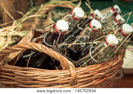 Many bottles with yoke plug in a wicker basket