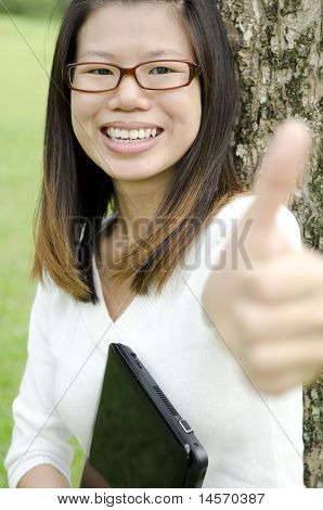 Asian Girl Giving Thumbs Up