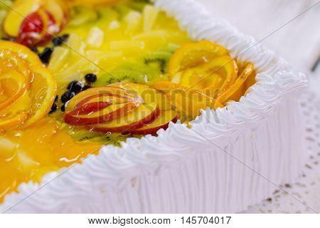 Dessert with fruits and cream. Pieces of apple in jelly. Delicious treat for party guests. Tasty cake from pastry shop.