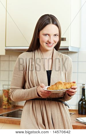 Woman Eating A Croissant