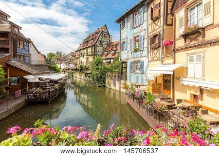 Colmar, Petit Venice, at dusk water canal and traditional colorful houses. Alsace, France.