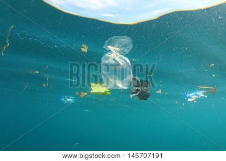 Water pollution. Plastic bags in sea environment.