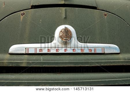 PLJEVLJA, MONTENEGRO - AUGUST 02, 2016: logo 'BEDFORD' on old green fire truck. Established in 1930 and constructing commercial vehicles, Bedford Vehicles was a leading international truck brand