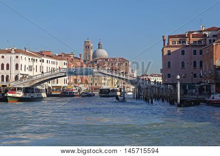 VENICE ITALY - DECEMBER 19: Bridge Over Grand Canal in Venice on DECEMBER 19 2012. Ponte degli Scalzi Near Train Station in Venice Italy.