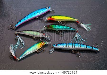 Colorful Fishing Lures On Black Glass