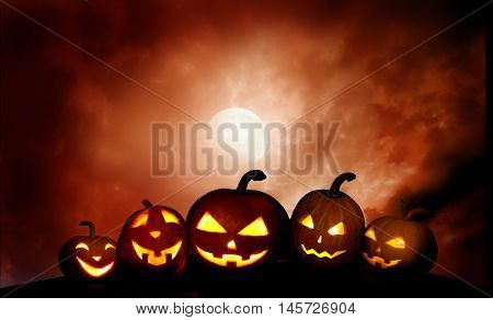 Scary  pumpkins jack-o-lantern in the night  .Halloween background