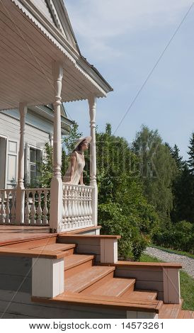The Girl On The Porch Of Manor