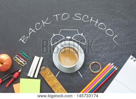 Back to school around a drawing of an alarm clock with a cup of coffee and stationery accessories