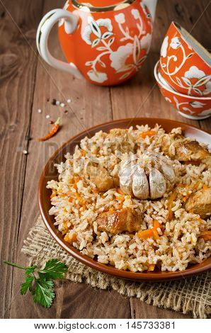Rice pilaf with meat and vegetables. Traditional middle eastern rice dish with meat carrots onions and lots of spices