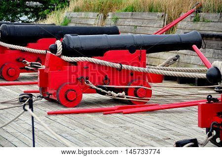 Baltimore Maryland - July 23 2013: 18th century cannons mounted on wooden trolleys at Fort McHenry National Historic Park