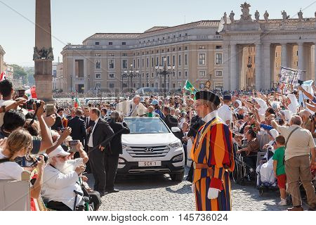Vatican City - September 3, 2016: Pope Francis on the new convertible, greets a crowd of joyful faithful flocked to St. Peter's Square for the celebration of the beatification of Mother Teresa of Calcutta.