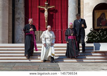 Vatican City - September 3, 2016: Pope Francis along with bishops, down the steps of the church square, in front of St. Peter's Basilica in the Vatican.