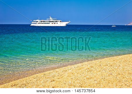 Yacht on Zlatni Rat paradise beach pebble and turquoise sea view Bol Brac island Croatia