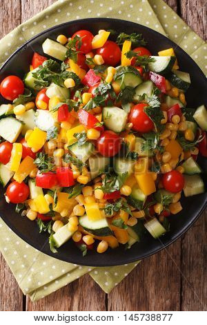 Low Calorie Salad Of Corn, Tomatoes, Cucumbers And Pepper Closeup. Vertical Top View