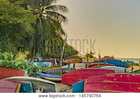 FORTALEZA, BRAZIL, DECEMBER - 2015 - Group of colored small fishing boats at sand in the beach of Fortaleza Brazil