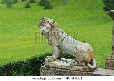 Lion sculpture on the stone stairs in the Park.