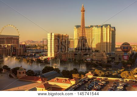 LAS VEGAS, USA - July 24, 2016: Day time fountain show at Bellagio hotel and casino on July 24, 2016 in Las Vegas, USA. The Paris Las Vegas hotel and casino, The Flamingo and Bally's hotels on Las Vegas Strip.