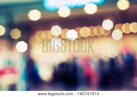 Bokeh city light and christmas light Night bokeh in shopping mall background vintage style for design