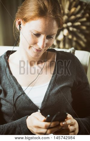 Woman Listening To Music At Home